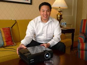 Vivitek's Christopher Yang withthe H1080P Projector